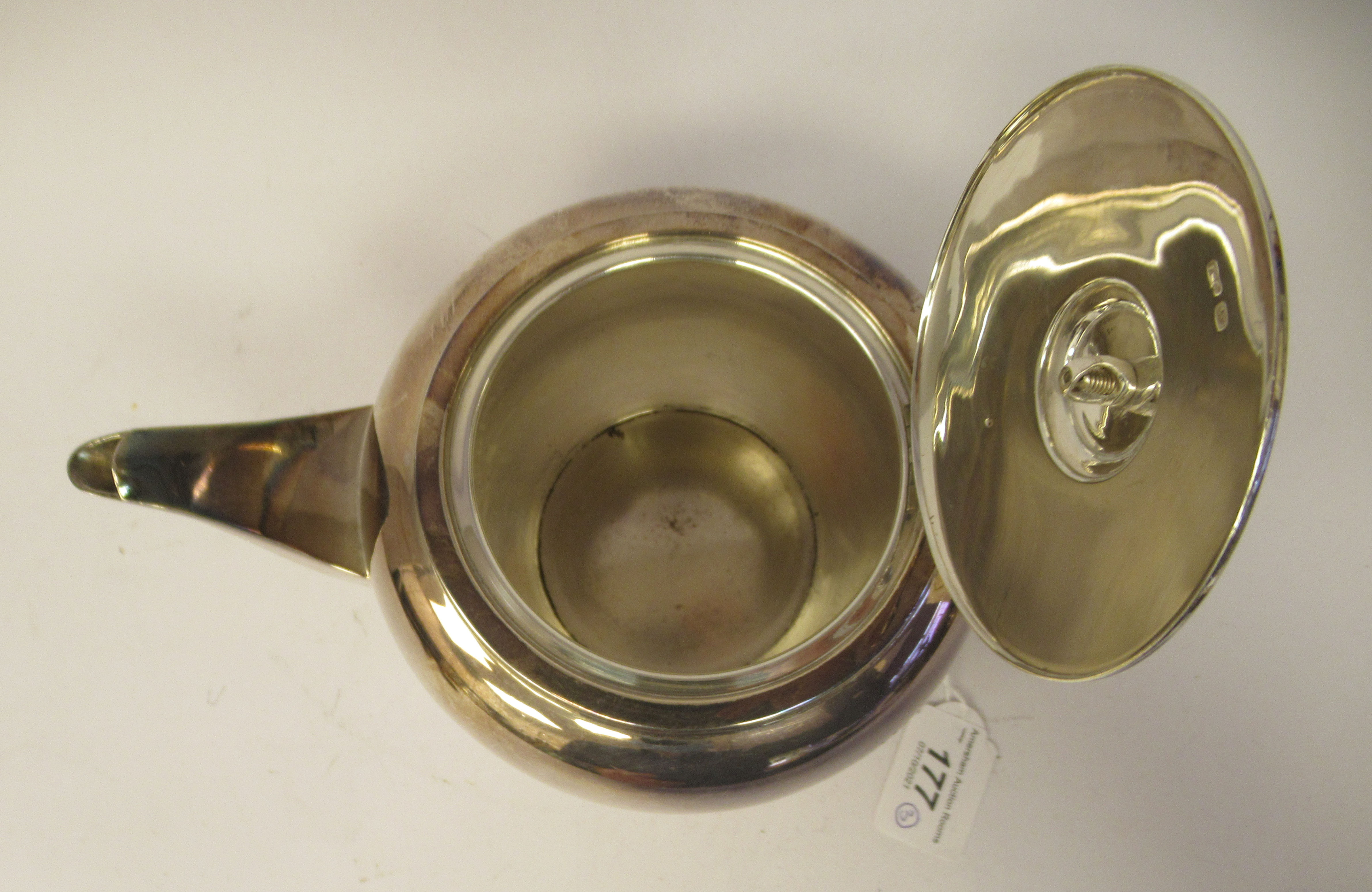 A three piece silver tea set of bulbous form, comprising a teapot with a short spout, an insulated - Image 2 of 6