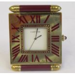 A Cartier Swiss made traveller's lacquered gilt metal cased timepiece of slim, square form with a