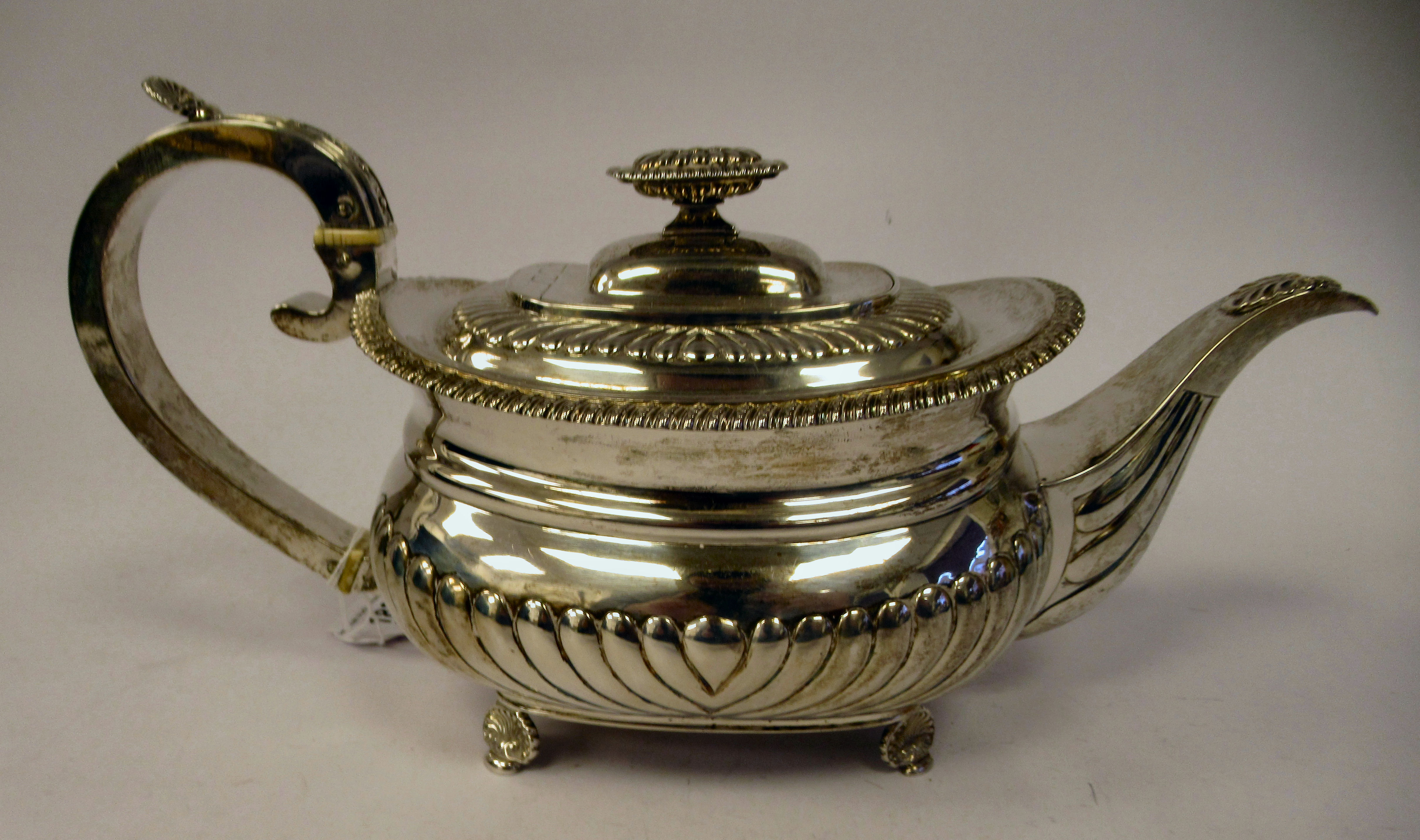 A George III silver teapot of squat, bulbous circular form with floral and foliate cast ornament, - Image 3 of 7