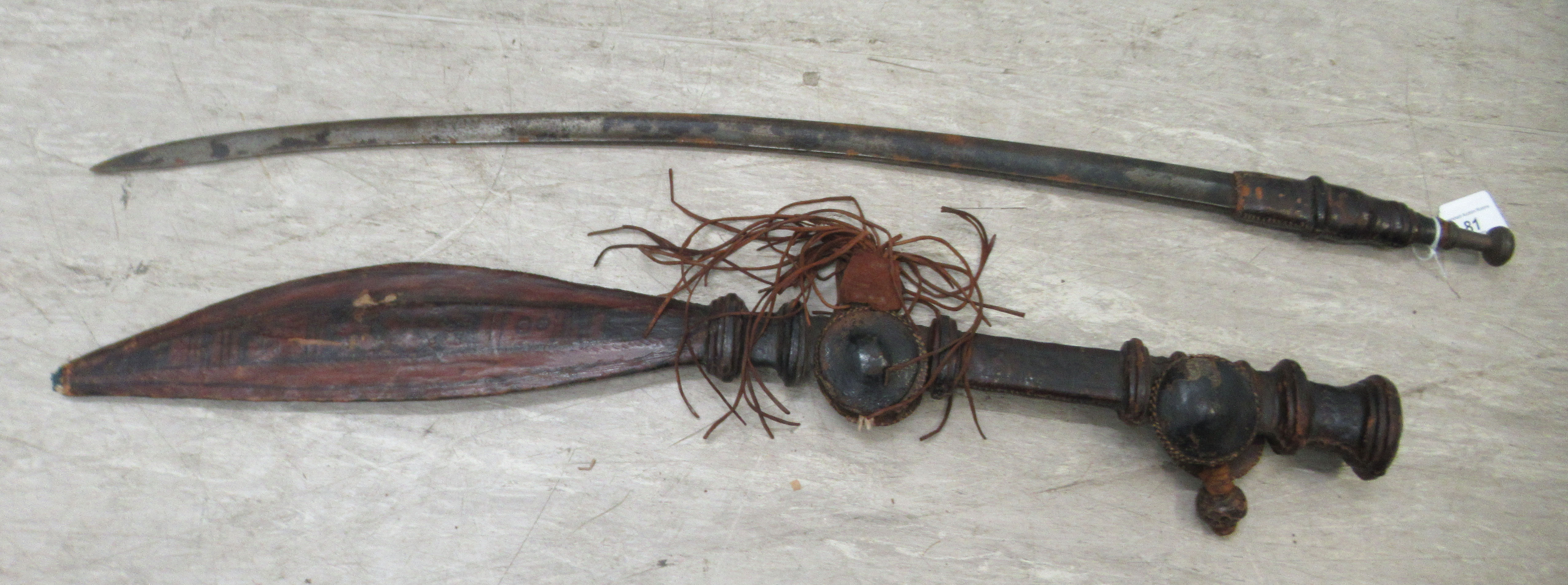 A late 19thC Islamic Tuareg Mandingo sword with a brown hide handle and decorative scabbard the - Image 2 of 6