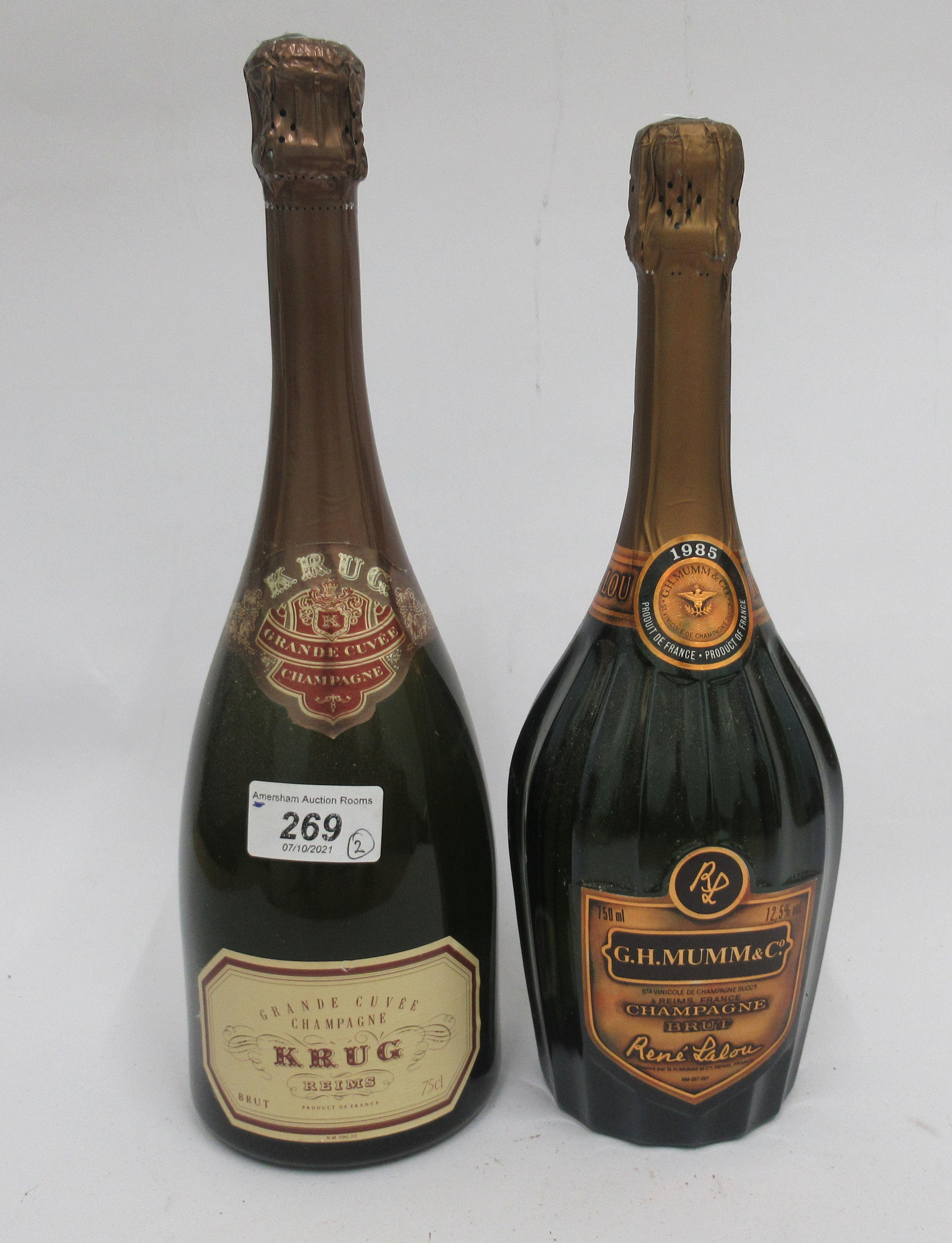 Wine, a bottle of 1985 G H Mumm & Co Brut Champagne; and a bottle of Krug Grande Champagne