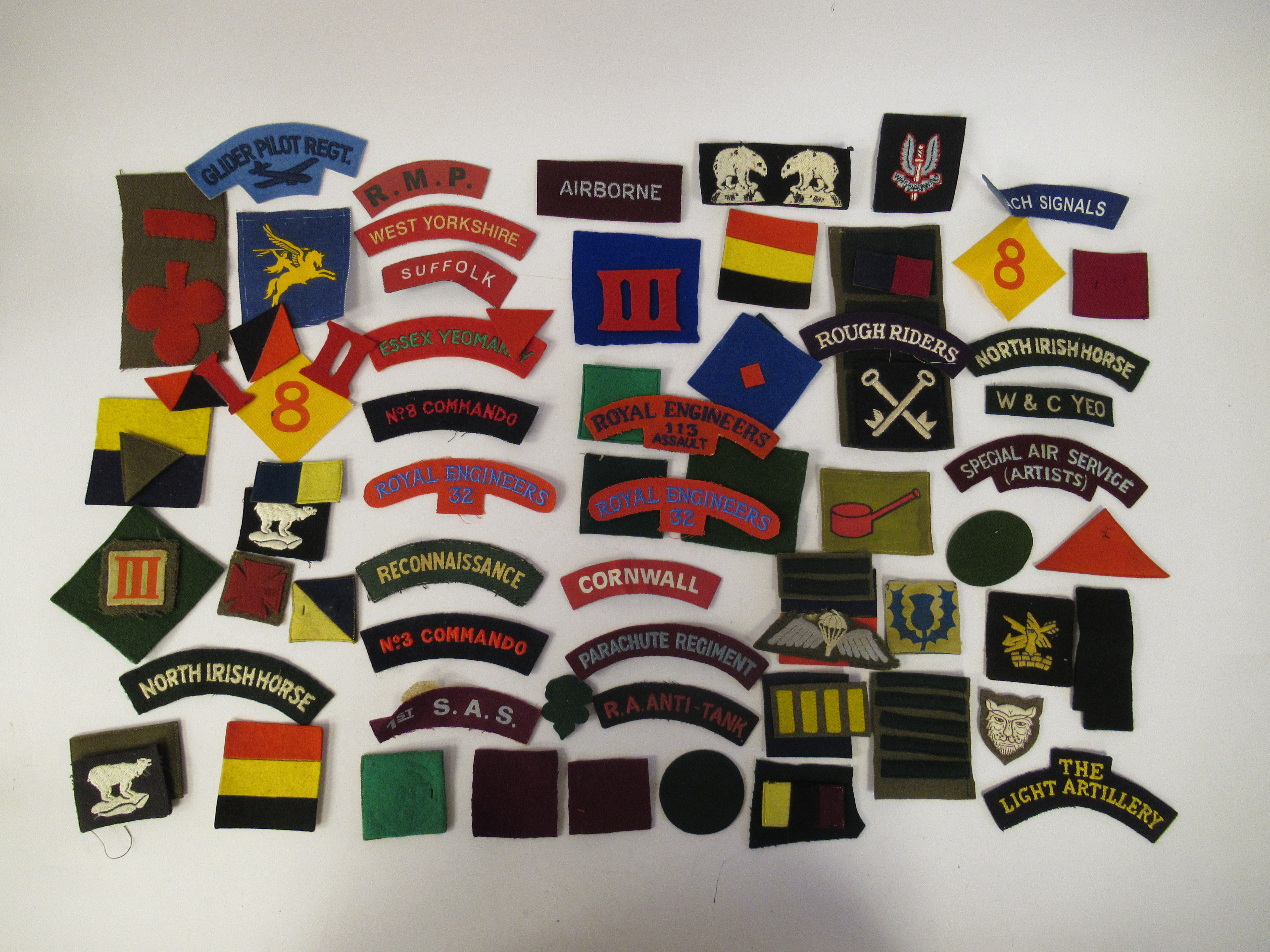 An uncollated collection of military cloth uniform badges: to include North Irish Horse, No8
