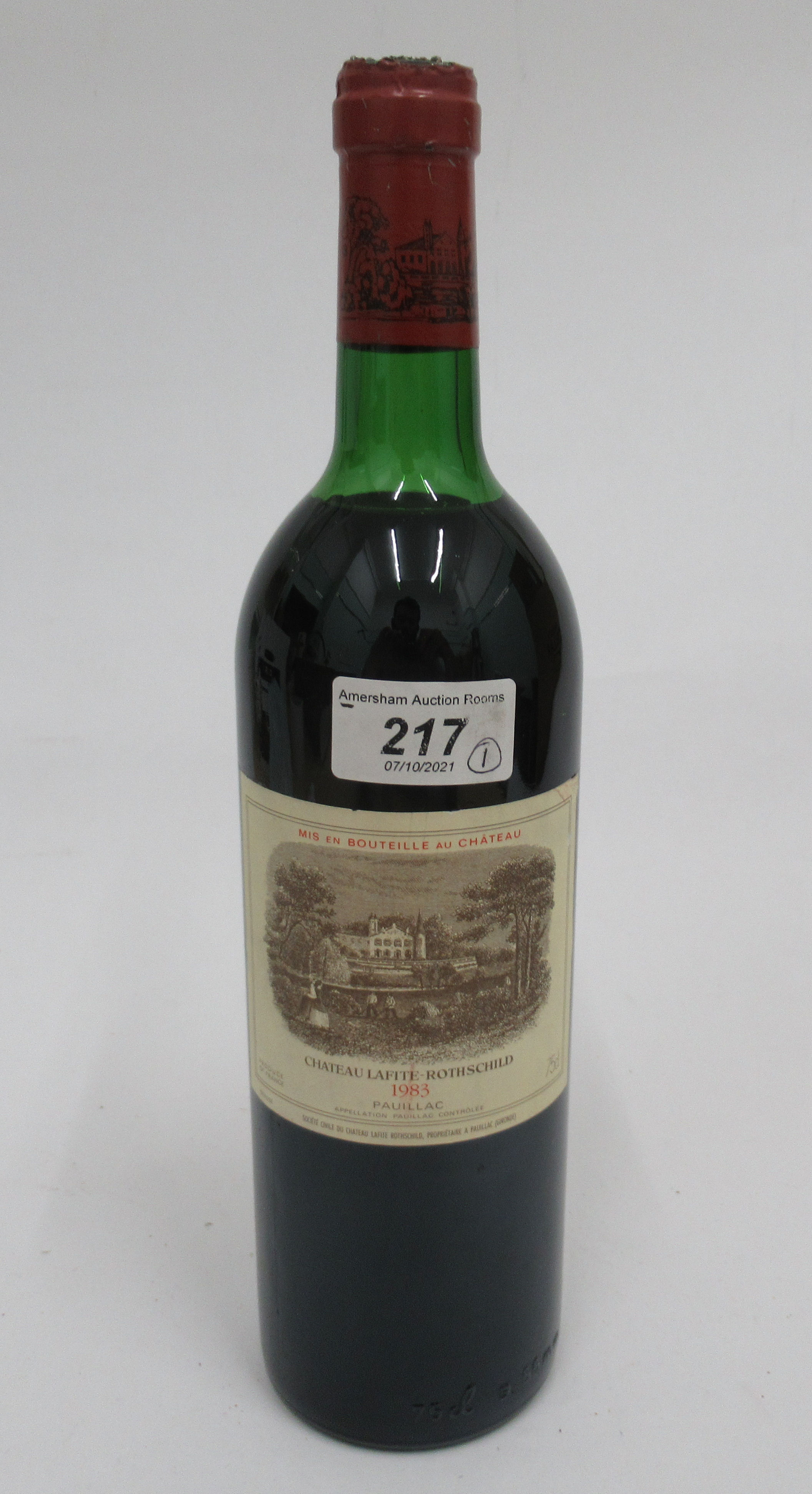 Wine, a bottle of 1983 Chateau Lafite Rothschild