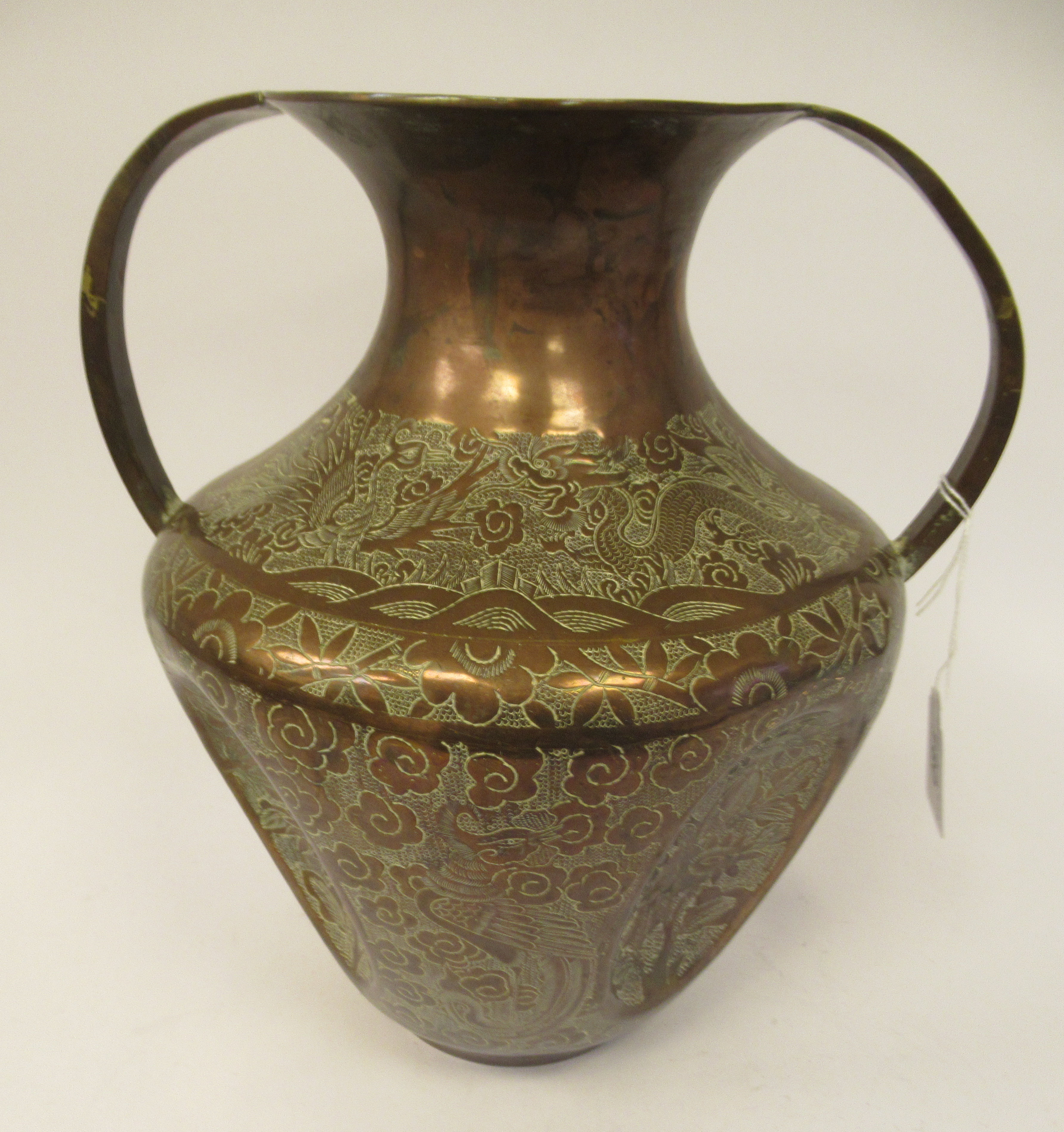 A late 19th/early 20thC Chinese copper vase of shouldered and dimpled baluster form, having a narrow