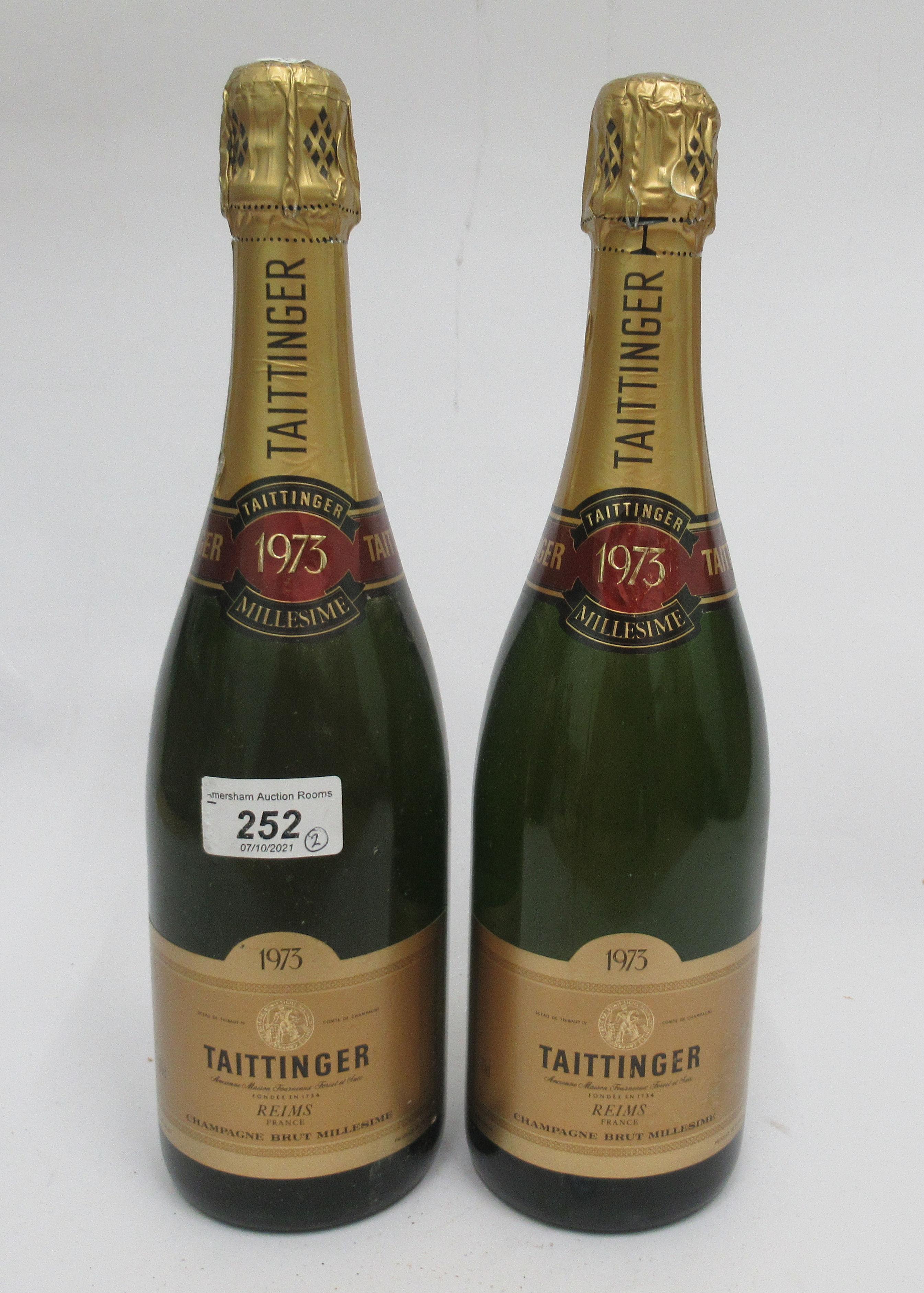 Wine, two bottles of 1973 Taittinger Millesime Champagne