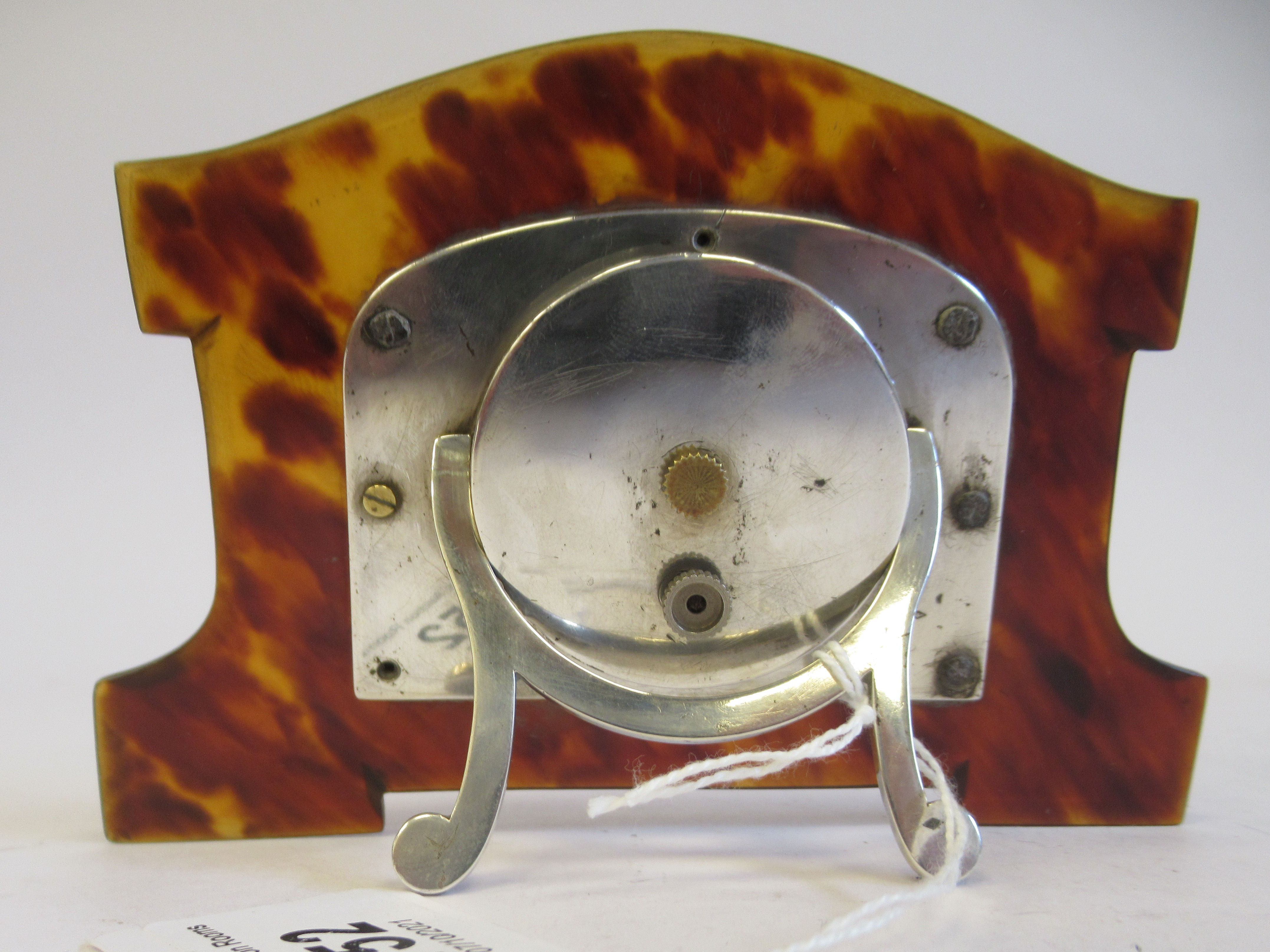 An Art Deco silver coloured metal cased mantel timepiece, set in a shaped tortoiseshell surround, on - Image 3 of 4