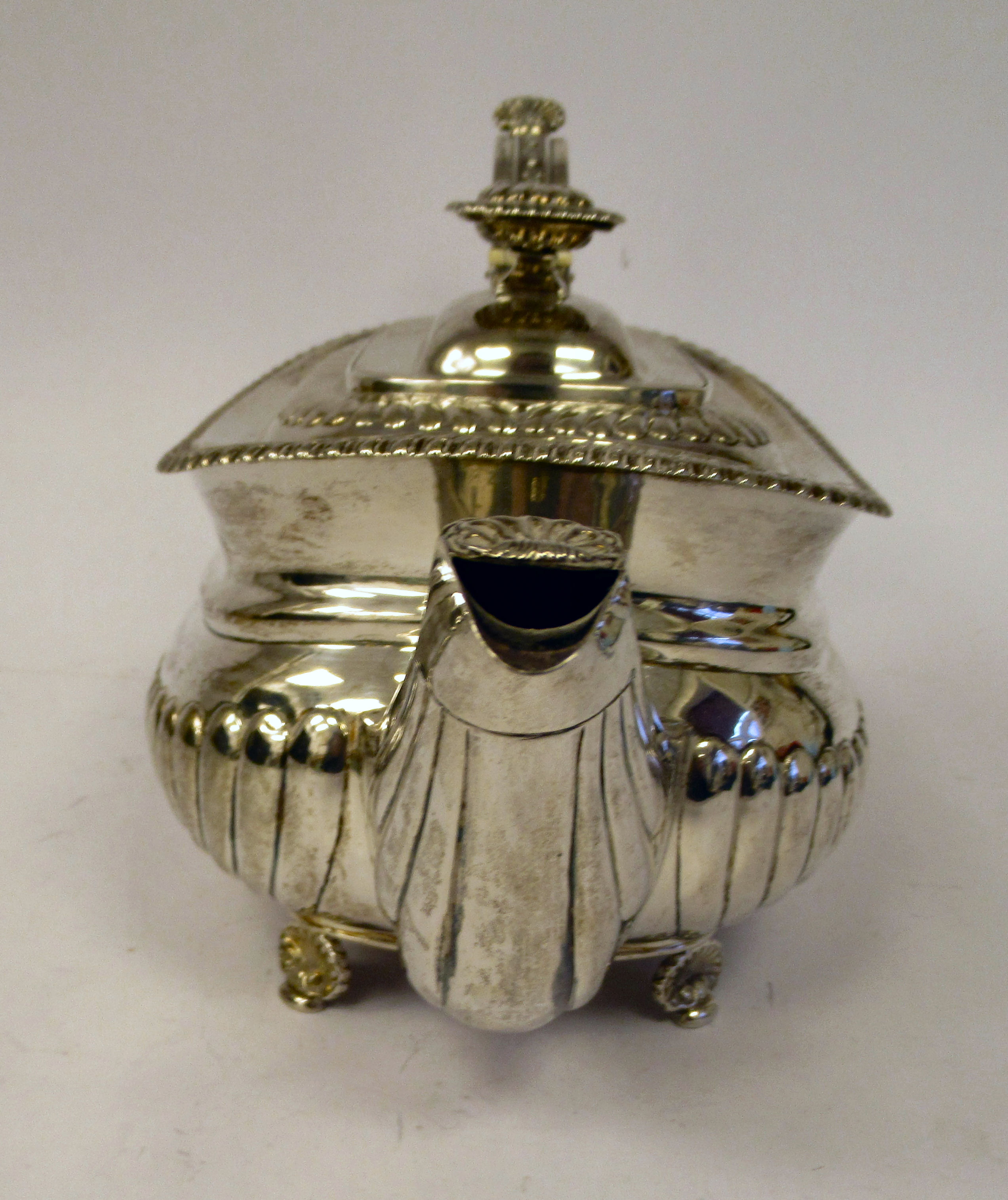 A George III silver teapot of squat, bulbous circular form with floral and foliate cast ornament, - Image 2 of 7