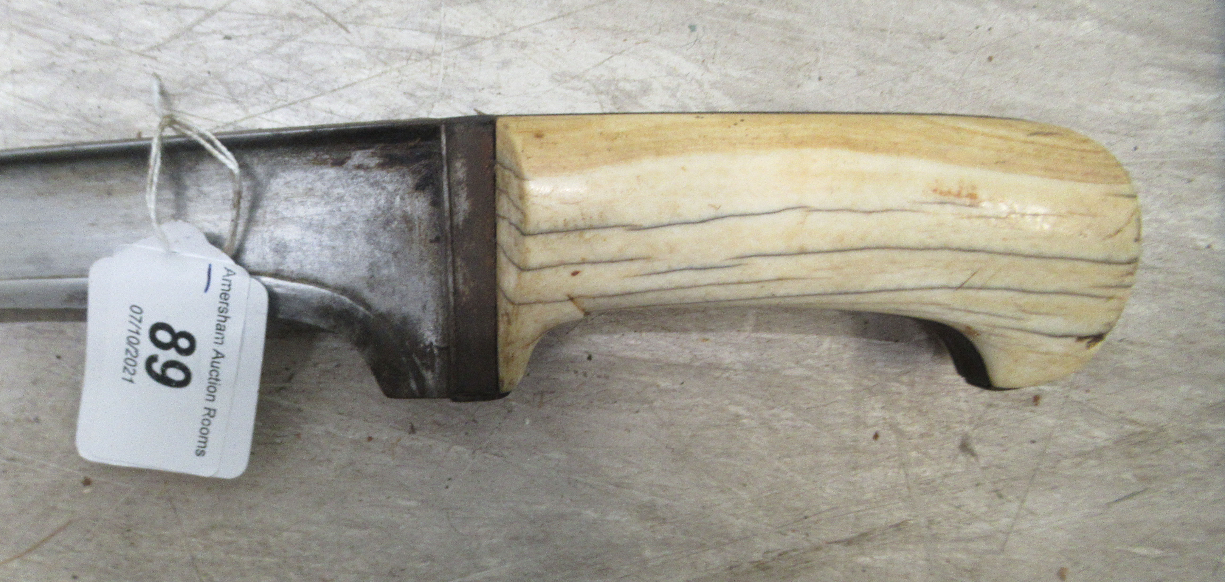 """A late 19thC Indo-Persian Pesh-Kabz dagger, on an ivory clad handle the blade 12""""L in a hide - Image 6 of 8"""