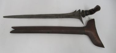 """A mid 19thC Malay Kris with a carved fruitwood handle and scabbard the Damascus blade 14.5""""L"""