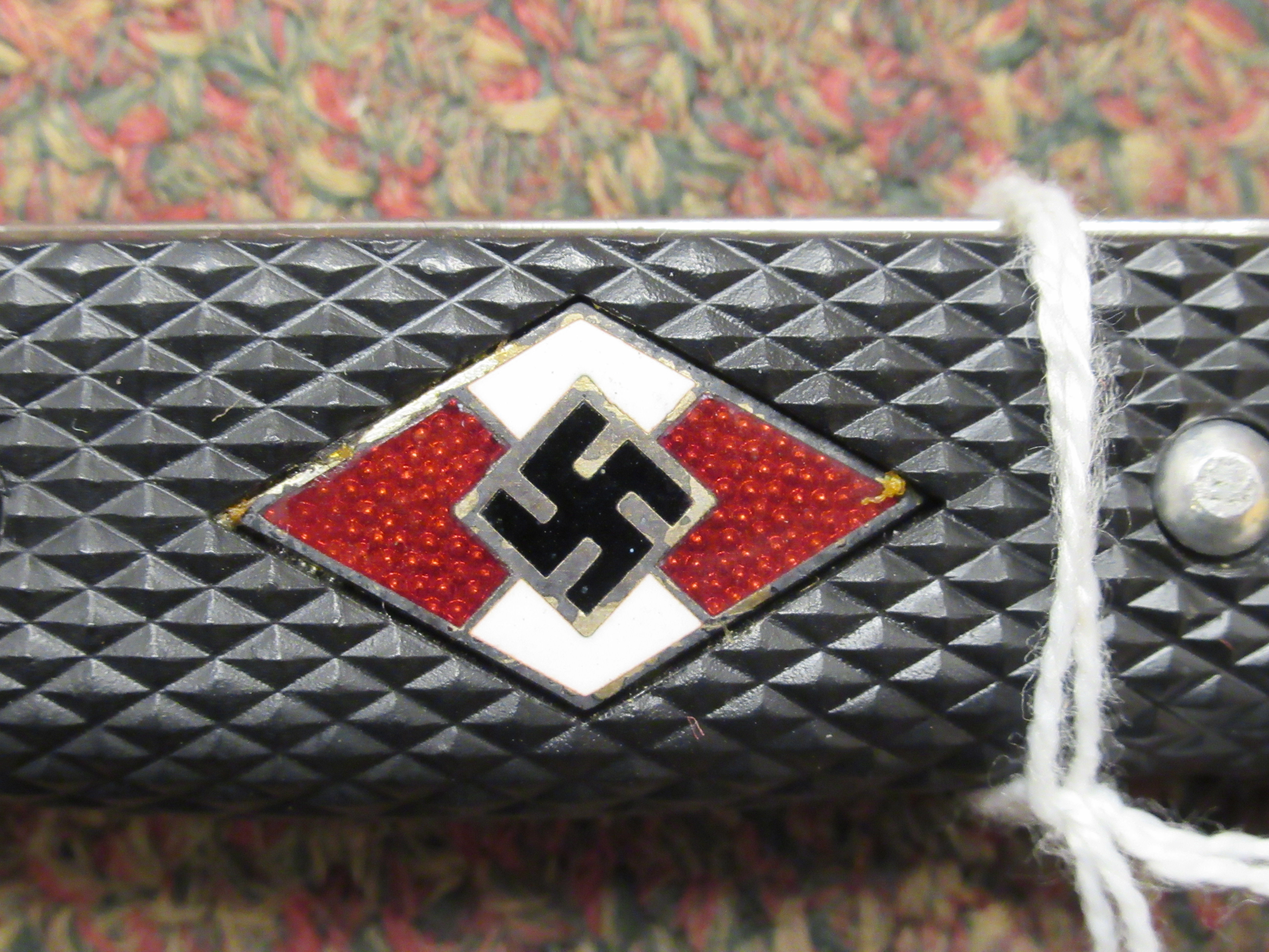 A Hitler Youth dagger, the rivetted grip plate incorporating a red, white and black enamelled - Image 6 of 6