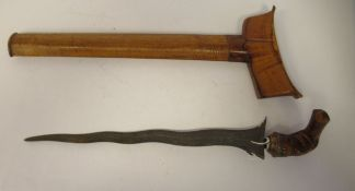A late 19thC Malay kris, having a carved, exotic hardwood bird's head handle, the traditionally