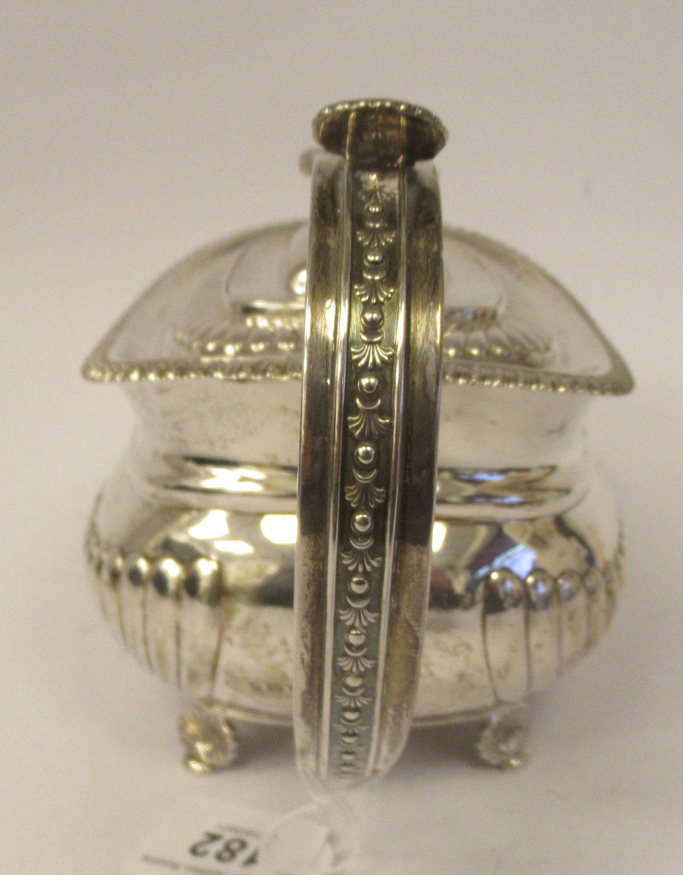 A George III silver teapot of squat, bulbous circular form with floral and foliate cast ornament, - Image 4 of 7