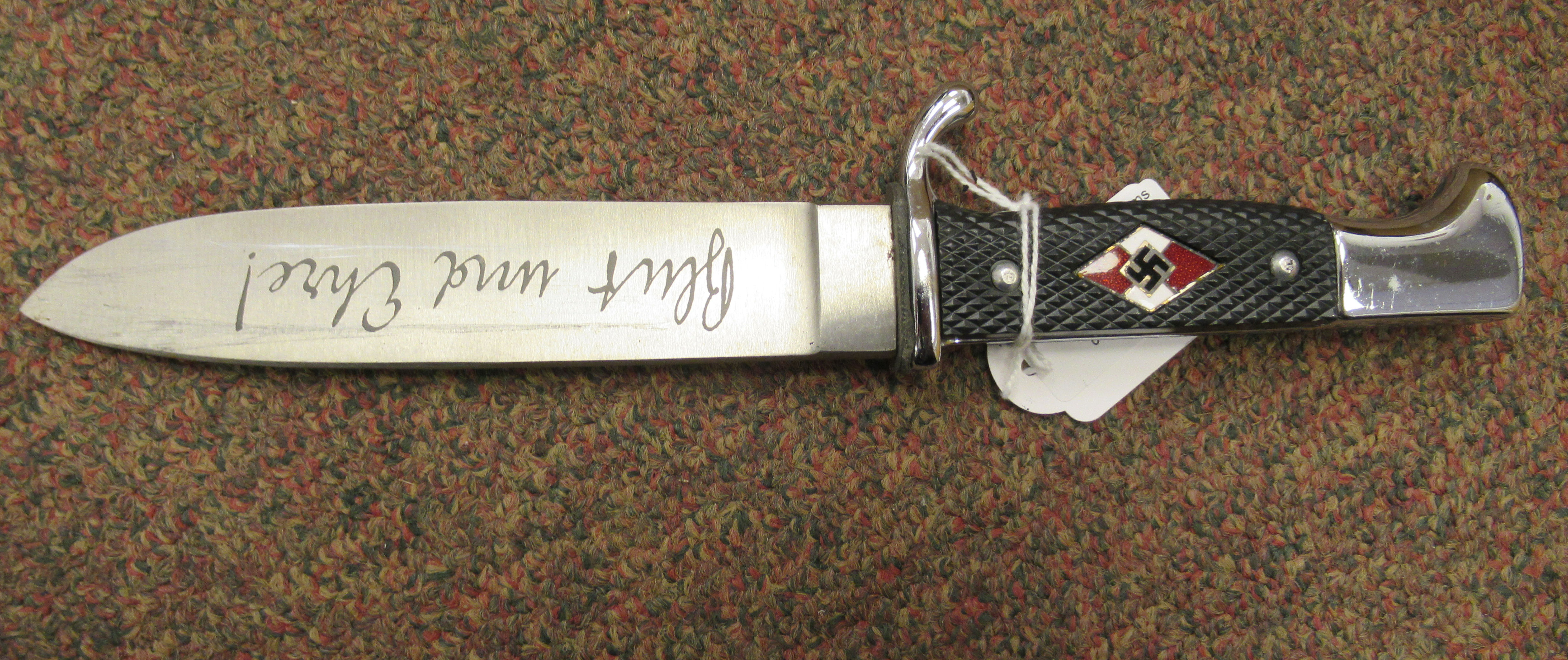 A Hitler Youth dagger, the rivetted grip plate incorporating a red, white and black enamelled - Image 3 of 6