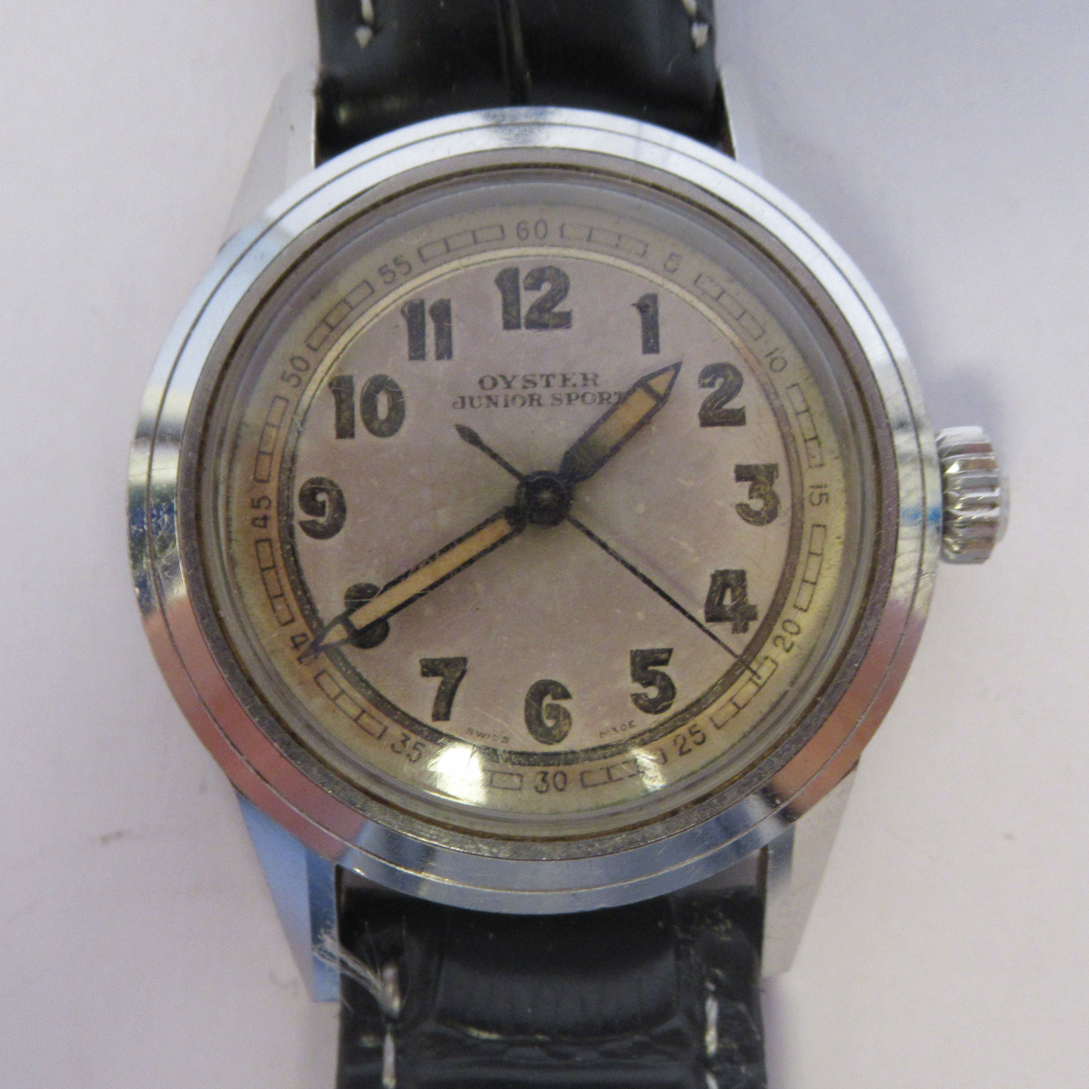 A 1940s boys Tudor Rolex Oyster Junior Sport stainless steel cased wristwatch, model 4454, the