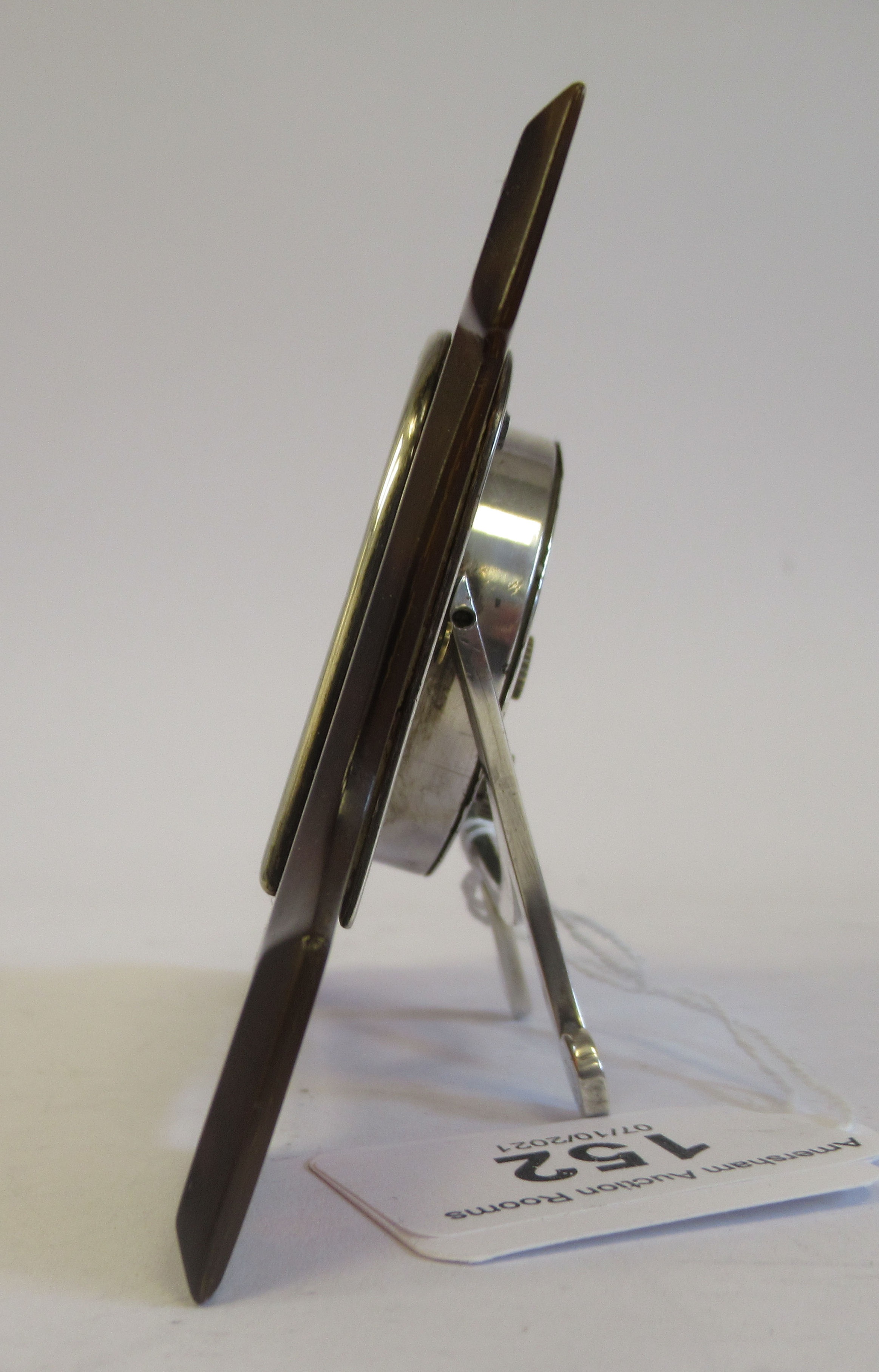 An Art Deco silver coloured metal cased mantel timepiece, set in a shaped tortoiseshell surround, on - Image 4 of 4
