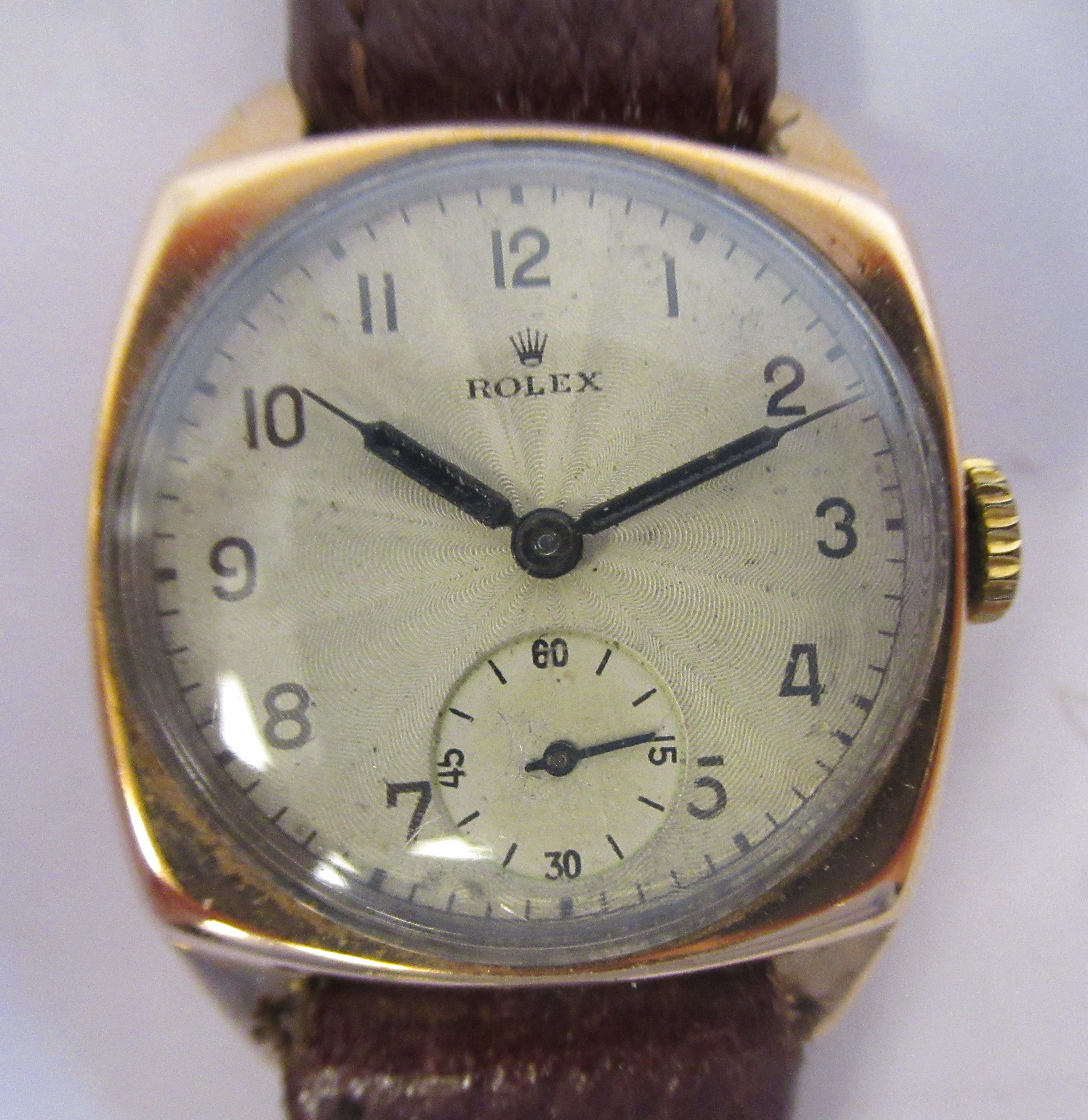 A 1942 Rolex 9ct gold cased wristwatch, faced by an engine turned Arabic dial,incorporating