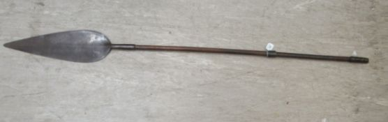 A 20thC African Zulu Iklwa spear with a broad leaf blade and a hardwood shaft, wrapped with spiral