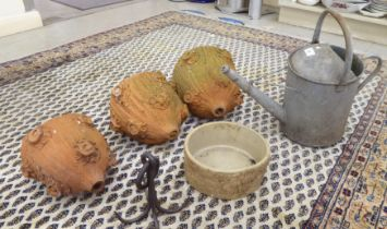 """Outdoor items, viz. a galvanised watering can; a cast iron hook; the terracotta wall planters 10""""h;"""