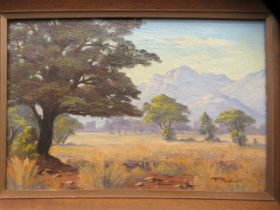 P Wort - a North East Transvaal South African landscape oil on canvas bears a signature & dated