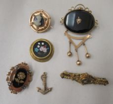 Six Victorian and later gold and yellow metal mourning and other brooches: to include a 15ct gold