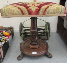 A William IV rosewood stool with a tapestry upholstered top over a tulip carved column, on lion