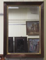 """A 20thC mirror plate, set in a Regency rosewood finished frame 18"""" x 27"""""""