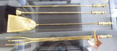 An (unused) set of Samuel Heath brass fire irons, comprising a hearth shovel, brush, poker and tongs