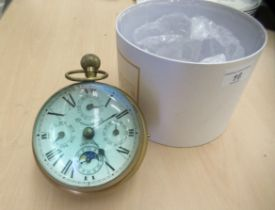 A 20thC lacquered brass and glazed desktop timepiece; faced by a Beaumont of Switzerland dial with