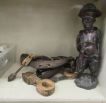 """Ethnic and tribal carved figures 21"""" & 19""""h; and various wooden artefacts"""