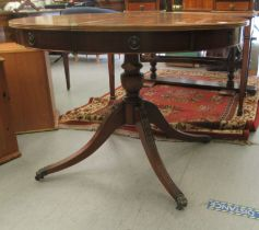 A Regency design, faux drum top mahogany dining table, comprising a pair of D-ends, raised on a