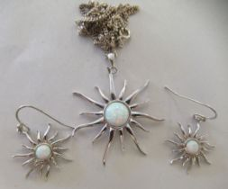 A pair of silver coloured metal 'sun' design, opal set earrings and a matching pendant