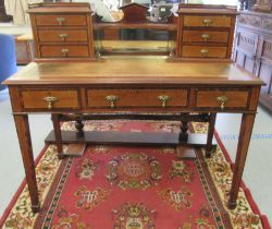 An Edwardian lady's crossbanded and satinwood inlaid mahogany writing desk, the superstructure