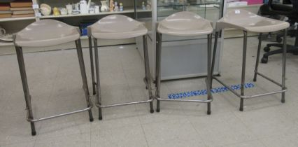 A set of four mid/late 20thC Steelux London, GLC Design tubular steel framed work stools with