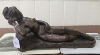 B G Harrison (after Manon) - a cast and patinated bronze figure, a reclining nude bears a signature