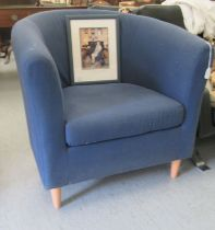 A modern tub style chair, upholstered in navy blue fabric with a cushion seat, raised on turned