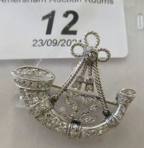 A white metal brooch, featuring the badge of 52 (Oxfordshire) Regiment of Foot, fashioned as a