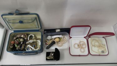 Costume jewellery and modern wristwatches