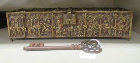 A late 19thC Gothic inspired brass casket, cast in panels with allegorical figure scenes, the