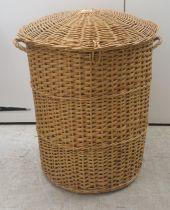 "A wicker laundry basket 25""h 30""dia"