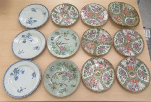 """A set of three late 18thC Chinese porcelain plates, lightly decorated with flora 9""""dia; and later"""