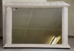 A modern overmantel mirror, the bevelled plate set in a weathered stone effect composition framed