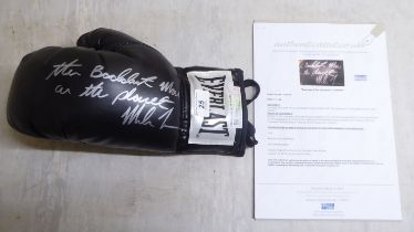 A left hand Everlast boxing glove, signed 'The Baddest Man on the Planet... Mike Tyson' with a