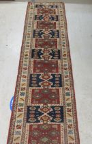 """A Persian runner, decorated with repeating stylised designs, on a multi-coloured ground 22"""" x 86"""""""