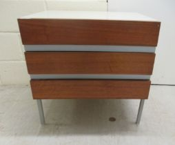 """An Opus 22 cream painted and three teak fronted drawer dressing chest, raised on square legs 24"""""""
