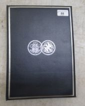 A cased book of twelve silver proof coins for 1981, commemorating the marriage of Lady Diana Spencer