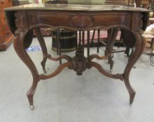 A late 19thC French walnut serpentine front sofa table with a frieze drawer, raised on cabriole legs