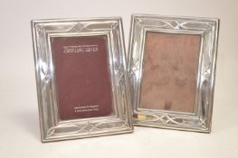 A pair of silver mounted photograph frames
