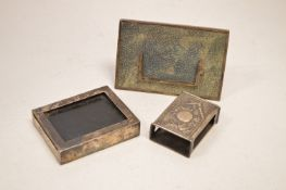 Chinese silver matchbox; and two desk top items