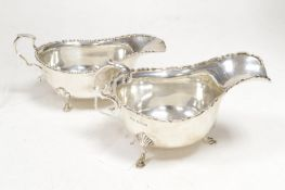 Two silver sauce boats