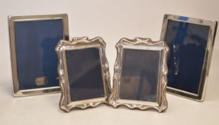 Two pairs of silver mounted photograph frames